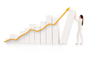 Business woman pushing a graph